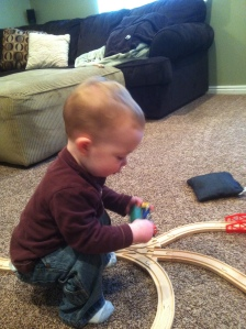 today we're playing lots of train while mom lays on the couch