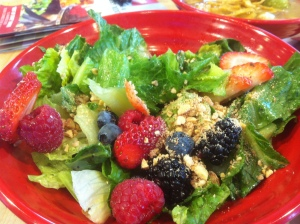 berry salad with caramelized nuts and poppy seed dressing