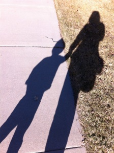 walking to my neighbors. J has discovered shadows and thinks they are magical